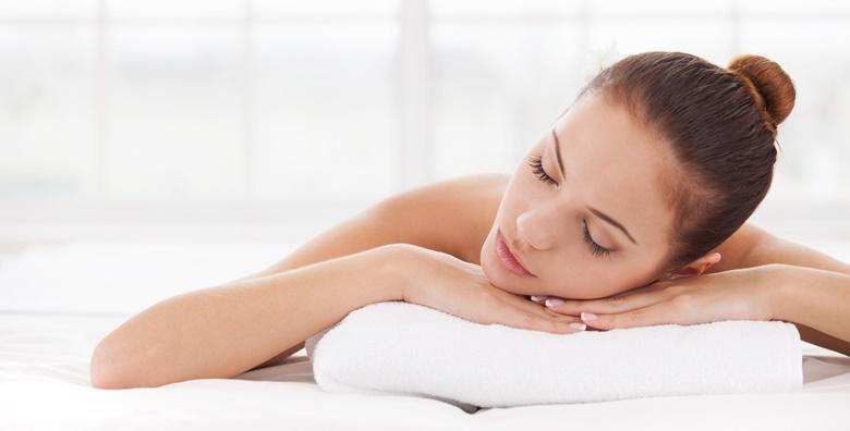 Masaža leđa ili nogu toplim ručnikom