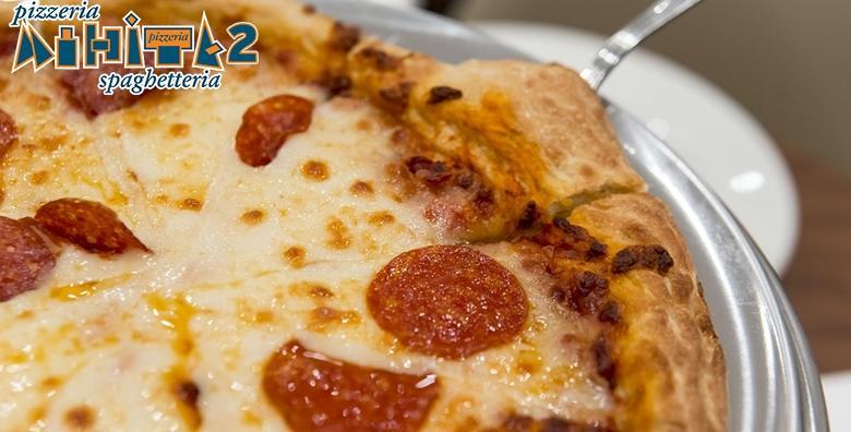 Ponuda dana: JUMBO PIZZA Hrskava korica, rastezljivi sir i sočni sos - odaberi Margharitu, Capriciosu ili Vesuvio i uživaj u slasnim okusima Pizzerije Mihita već od 53 kn! (Pizzeria Mihita 2)